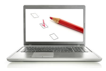 23678812 - laptop with red pencil and check boxes on screen. online survey concept.